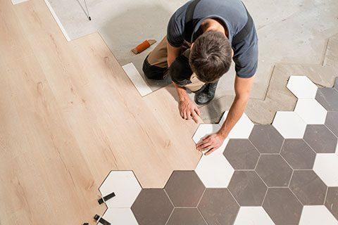 Contractor installing flooring as part of a kitchen renovation - Renovating your kitchen? Think about our five F's! | Dash Builders