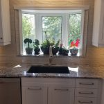 A marble countertop and a brand new sink for a kitchen renovation - Kitchen Renovations Winnipeg - Dash Builders
